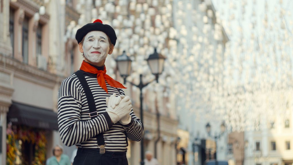 a mime standing on the street