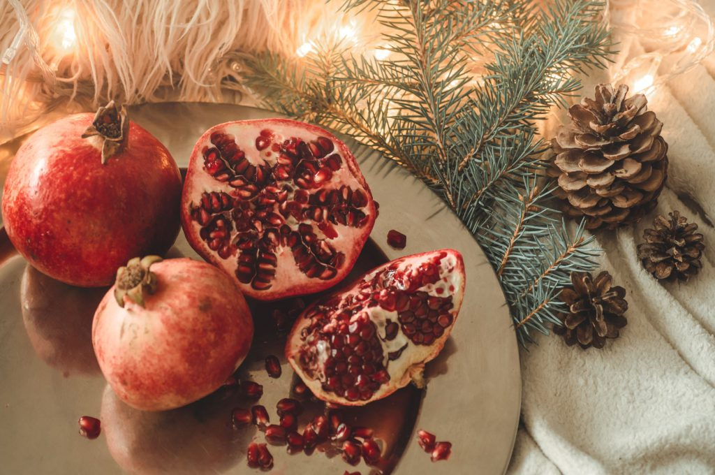 pomegranate fruit in a winter composition