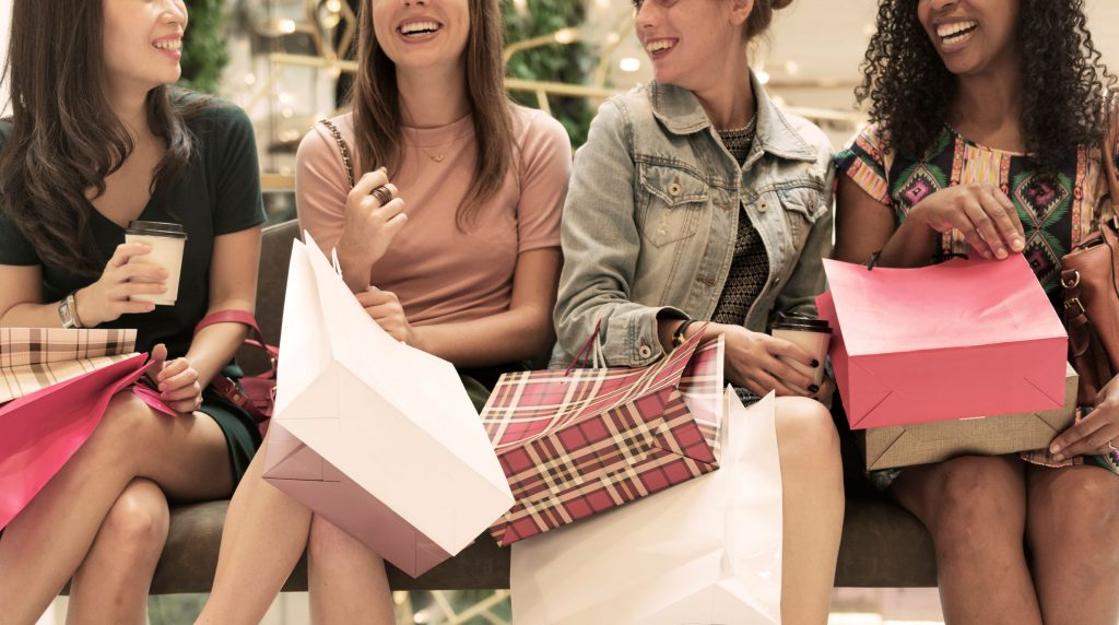 group of young women with shopping bags