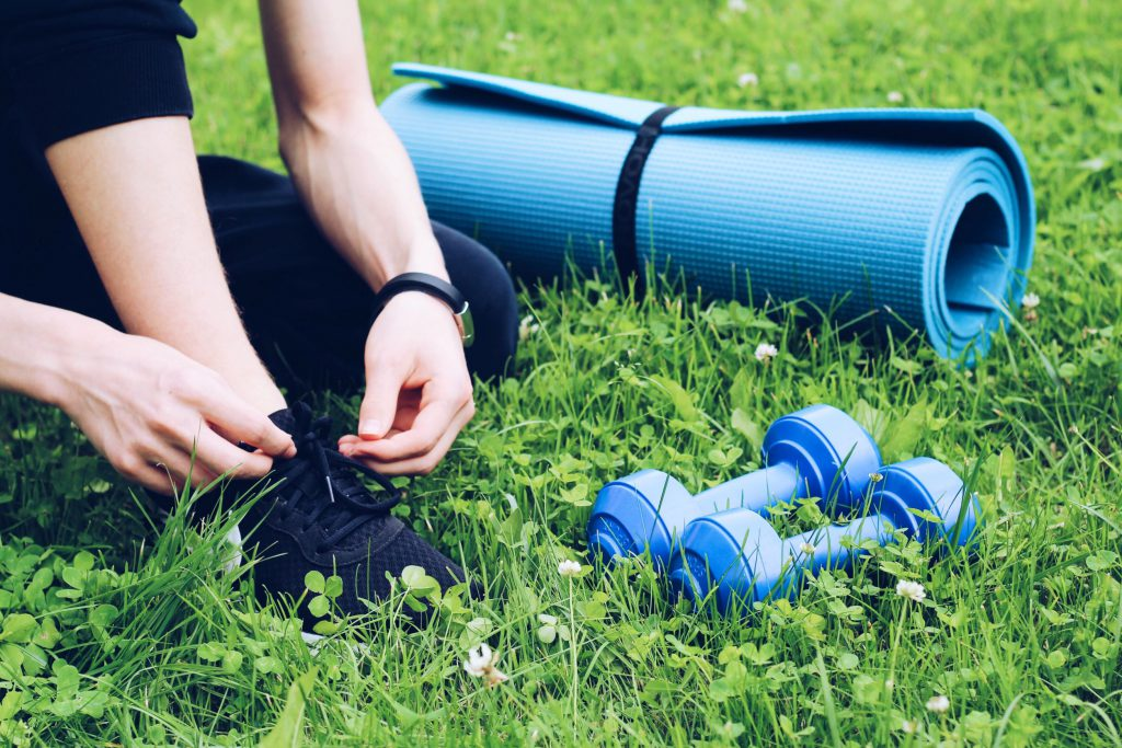 fitness concept with yoga mat and dumbbells