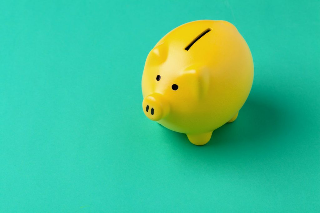 yellow piggy bank on a teal background
