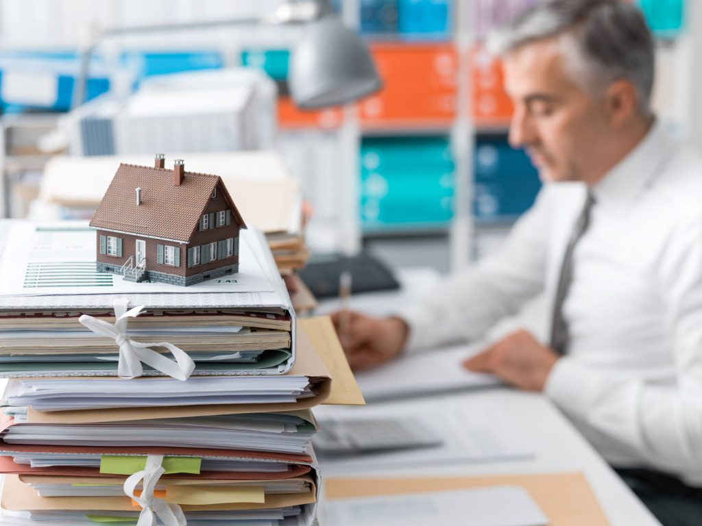 mortgage broker with small model house